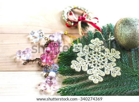 Snowflake and Christmas ornaments on wooden background / style blur and select focus