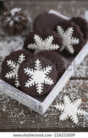Snowflake, chocolate, Christmas cookies on old wood table