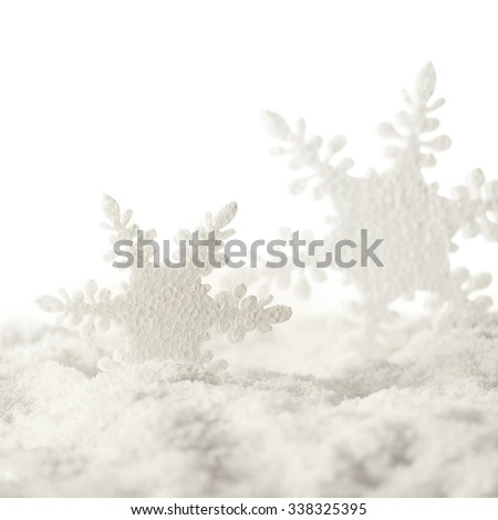 snowflake christmas ornaments and snow - stock photo