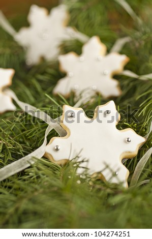 Snowflake cookies over an Christmas tree - stock photo