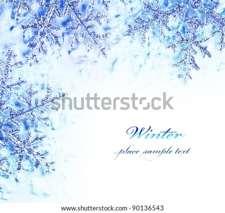 Snowflake decorative border, beautiful blue cold frozen snow background, Christmas tree ornament and decoration, winter holidays abstract frame with text space - stock photo