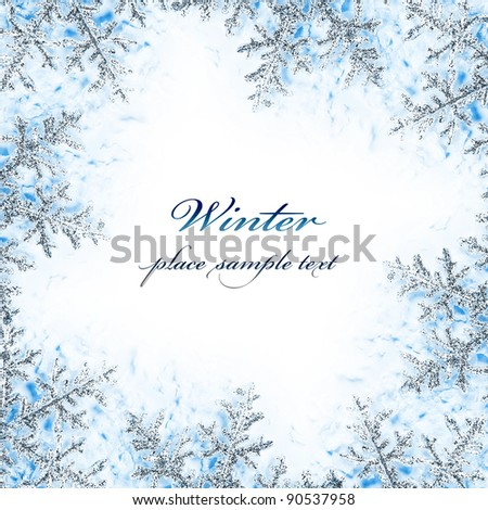 Snowflake decorative frame, beautiful blue cold frozen snow background, Christmas tree ornament and decoration, winter holidays abstract border with text space - stock photo