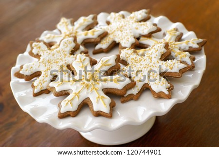 Snowflake gingerbread cookies, decorated with icing and sprinkles. - stock photo