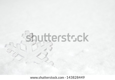Snowflake in the snow with - stock photo