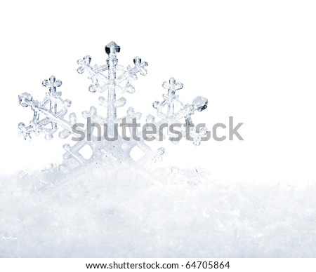 Snowflake in white snow. Isolated. - stock photo