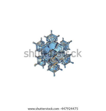 Snowflake isolated on white background: macro photo of real snow crystal, captured on sheet of glass with LED back light. This small stellar dendrite snowflake have beautiful arms and relief surface. - stock photo