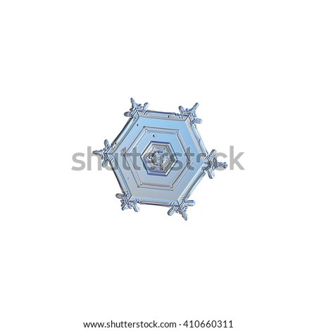 Snowflake isolated on white background: real snowflake macro photo, captured on glass surface with LED back light. This is large snow crystal of hexagonal plate type with unusual tiny branches.