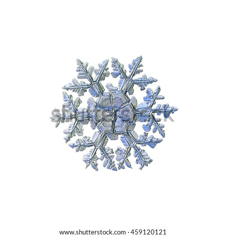 Snowflake isolated on white background. This is macro photo of real snow crystal: large stellar dendrite with complex arms, massive sectored center and frozen bubbles of rime on surface. - stock photo