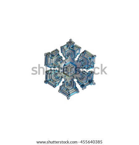 Snowflake isolated on white background. This is macro photo of real snow crystal with six broad arms and several frozen bubbles of rime on surface.