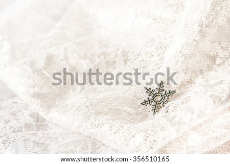 snowflake on ornamental lacy white background