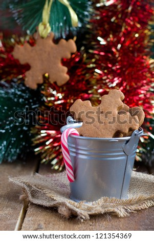 Snowflake shape Christmas gingerbread Cookies on sacking and on the Christmas Tree