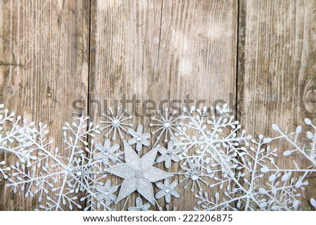 Snowflakes border on grunge wooden background. Winter holidays concept. - stock photo