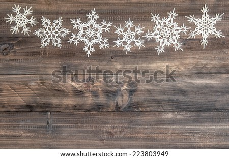snowflakes border over rustic wooden background. christmas decoration - stock photo