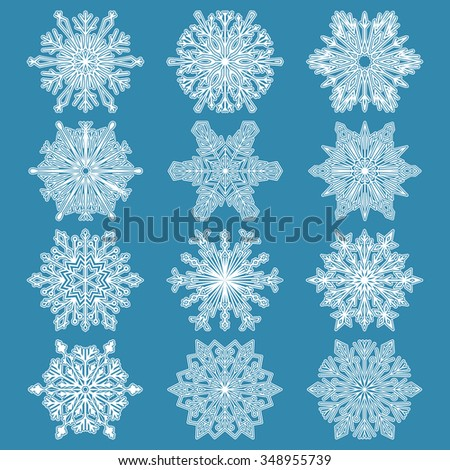 Snowflakes icon collection-2. White snowflakes on a blue background. Graphic ornament