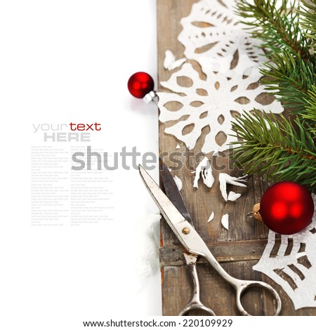 Snowflakes  made of paper and christmas tree on wooden background - stock photo