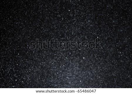 snowflakes on dark sky - stock photo