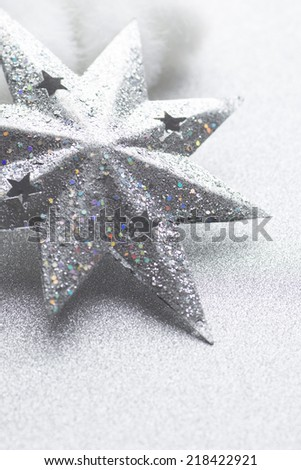 Snowflakes on silver background. Christmas greeting card. - stock photo