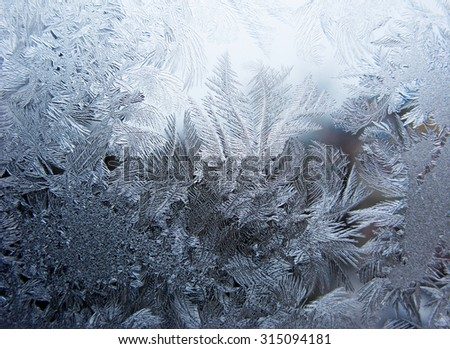 snowflakes ornament on glass winter texture background