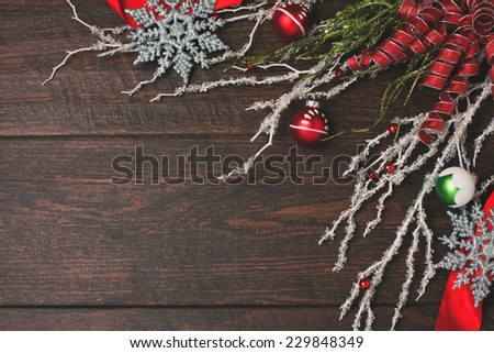Snowflakes, ribbon, crystal and ornaments on a wood background - stock photo