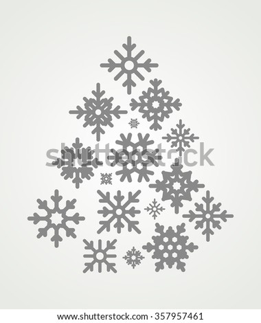 Snowflakes set  in the form of a Christmas tree. Snowflakes icons on gray background. - stock photo