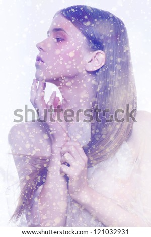 snowflakes winter portrait fashion face freeze wind blue gamma ice looking - stock photo