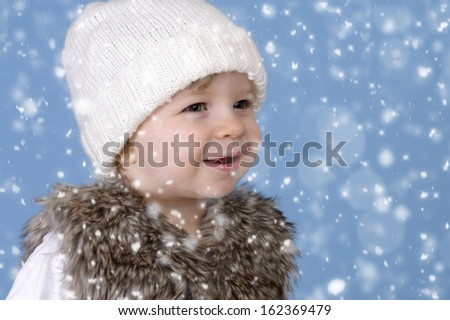 snowing on a little toddler