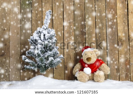 snowing on christmas bear - stock photo