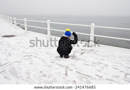 Snowing on the shore at the Black Sea, in Constanta, Romania.  - stock photo