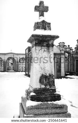Snowing panorama with snow of a country cemetery, in the countryside region of Lomellina (between Lombardy and Piedmont, Northern Italy). Black and white photo - stock photo