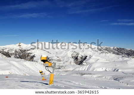 Snowmaking in ski slope at sun day. Greater Caucasus, Mount Shahdagh. Qusar rayon of Azerbaijan.
