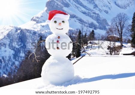 Snowman against Alpine panorama - stock photo