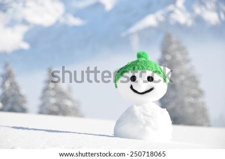 Snowman against Alpine scenery - stock photo