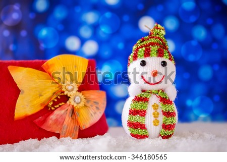 Snowman, and gift on snow day, In Merry christmas night. Soft focus