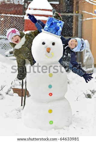 snowman  and kids - stock photo