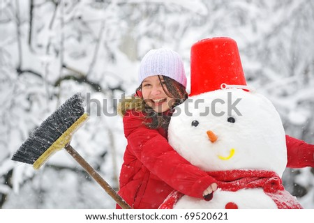 snowman and young girl - stock photo