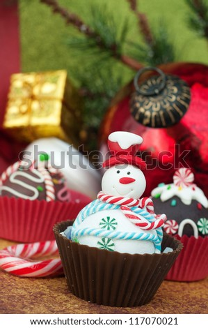 Snowman Christmas cupcake - stock photo