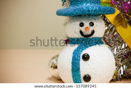 snowman,colorful Christmas decoration on wood background.