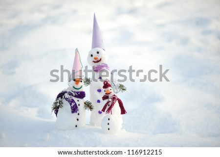 Snowman father mother and kid - stock photo