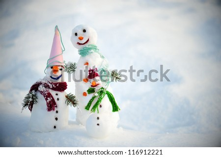 Snowman friends together - stock photo