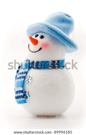 snowman in a blue hat on a white background - stock photo