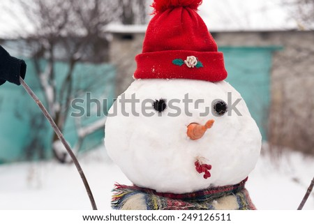 Snowman in a red cap, Russian Winter