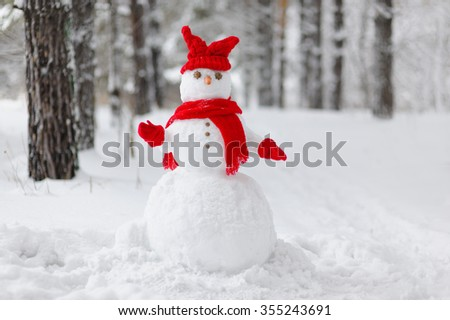 Snowman in a winter forest - stock photo