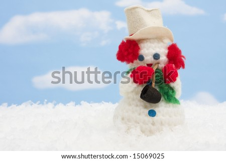 Snowman in outdoor scene
