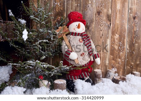 Snowman in winter decor - stock photo