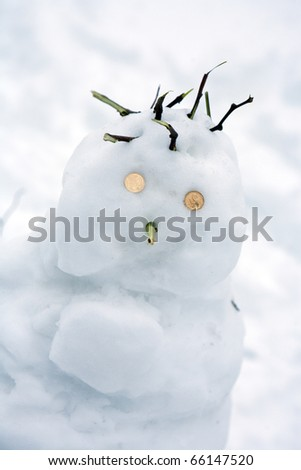 Snowman on a background of snow with coins place the eye - stock photo