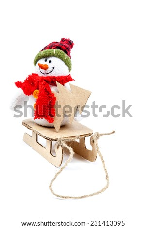 Snowman on a sled with Christmas tree isolated on a white background. - stock photo