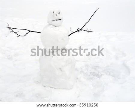 Snowman on white snow background - stock photo