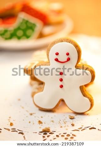 Snowman shaped Christmas cookie - shallow DOF. - stock photo