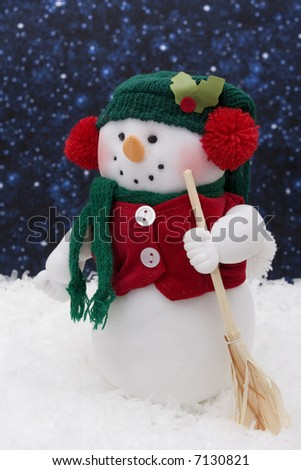 Snowman sitting on snow, night background - stock photo