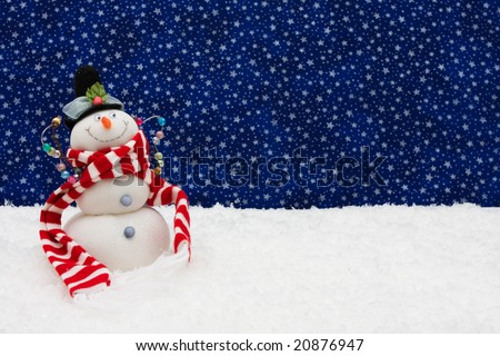 Snowman sitting on snow with a star background, snowman